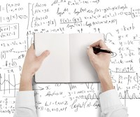 Whiteboard with mathematical formulas and a person taking notes