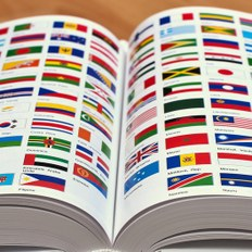Encyclopedia pages showing world flags Photo by Horia Varlan via Flickr